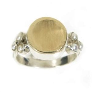 Silver and gold ring set with white pearls
