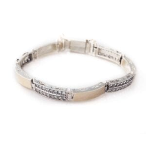 Silver bracelet combined with 9k gold set with gorgeous gems.