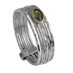 Beautiful silver and gold ring set with Peridot gem