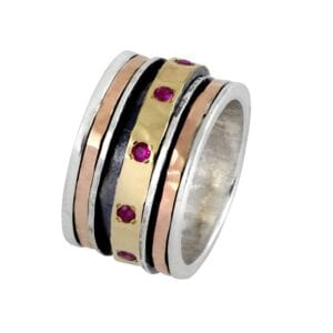Exquisite Spinning silver and gold ring with Ruby gems