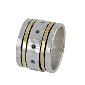 Beautiful silver and gold spinning ring with Sapphire corundum