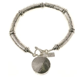 Chunky hammered sterling silver gorgeous bracelet, with a round pendant charm and a T bar clasp