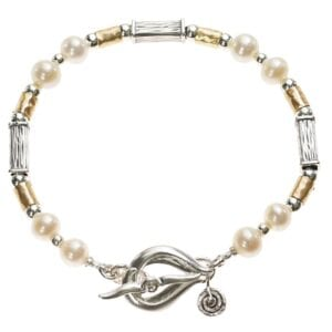 Pretty Sterling Silver and 14k Rolled Gold bracelet with freshwater Pearls, finished with an ornate T-Bar clasp and spiral charm