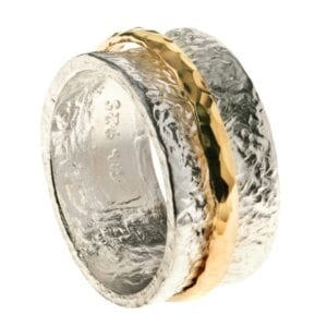 Gorgeous spinning sterling silver ring combined with 14k rolled gold. Hammered affect finish