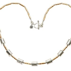 Beautiful hammered silver necklace with 14k Rolled Gold beads, finished with a spiral clasp