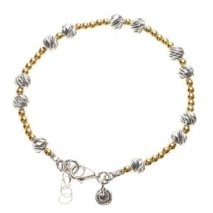 Adorable Sterling Silver bracelet with 14k Rolled Gold and Silver beads with a spiral charm