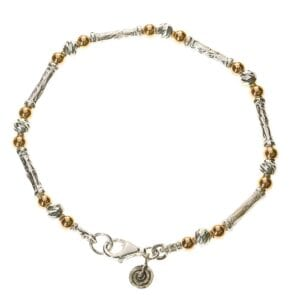 Stunning bracelet of Sterling Silver tubes and beads combined with 14k Rolled Gold and a pretty spiral charm