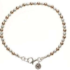 Attractive Sterling Silver and 14k Rolled Gold bead bracelet with carved detail