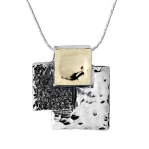 Stunning necklace of three squares in 9k gold, shiny and oxidised Sterling Silver with textured finishes