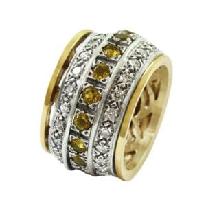Silver and 9k gold revolving ring set with blue citrine and Cubic Zircona gems. Revolving rings are also called Tibetan worry rings. A revolving, or spinner ring consists of an inner band and outer bands, where the outer bands spin freely around the inner