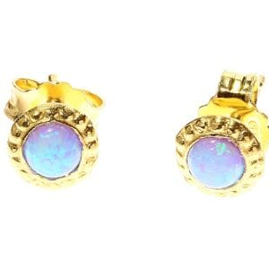 Lovely sterling silver with 24k gold plate studs set with round opalite gems