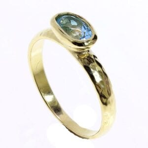 Sterling silver with 24k gold plate stacking ring set with blue topaz