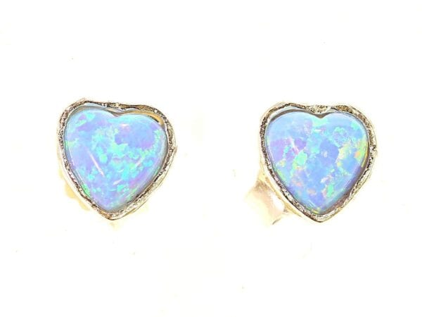 Sterling silver studs set with heart shaped opalite gems