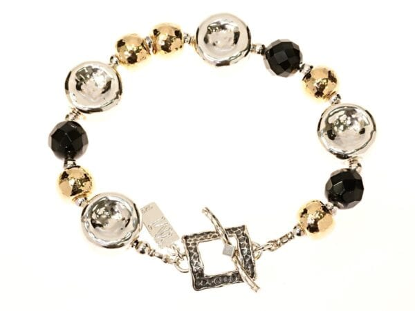 Handmade sterling silver bracelet with faceted black onyx gems and 14k rolled gold beads. Fancy square t bar clasp
