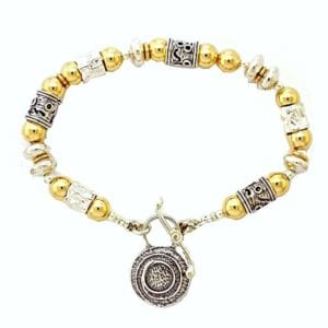 Adorable sterling silver with 14k rolled gold bracelet with lovely circular pendant t bar clasp