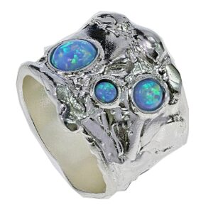 Beautiful broad sterling silver ring with hand finished pattern set with three opalite gems