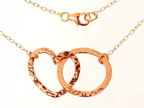 Romantic 14k rolled gold entwined heart and loop necklace with hammered finish