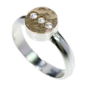 Contemporary sterling silver and 14k rolled gold ring with triple settings of cubic zirconia gems