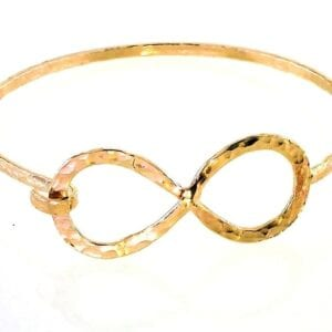 Gorgeous 14k rolled gold hammered finish opening hammered finish bangle with figure of 8 detail