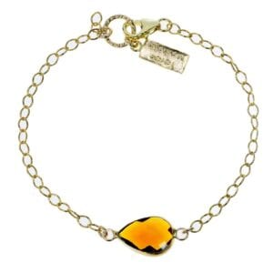 Adorable sterling silver with 14k rolled gold bracelet with amber coloured teardrop