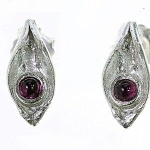 Cute sterling silver stud earrings set with amethyst gems